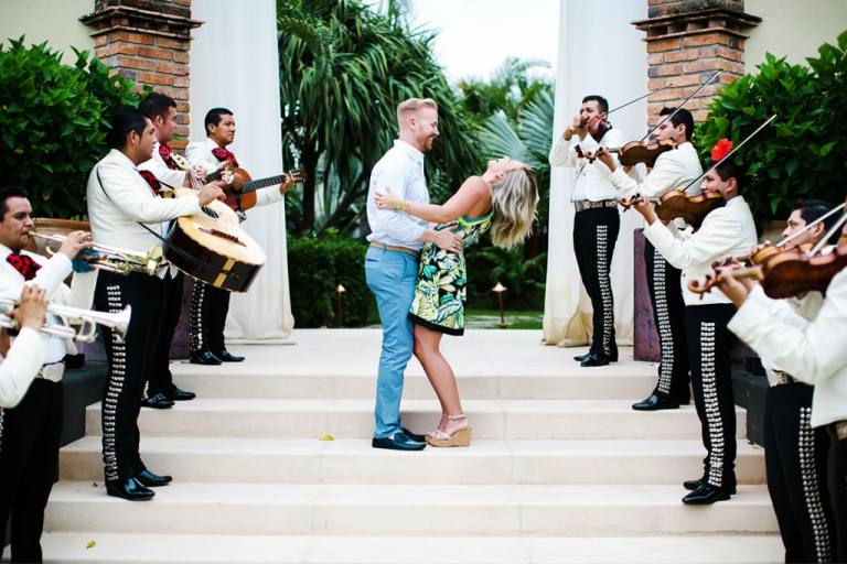 Couple on stairs with mariachi band