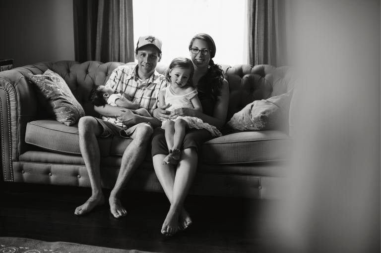black and white family on couch
