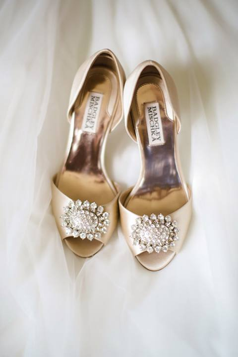 Shoes resting on wedding dress